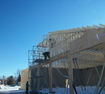 Picture of Madawaska Multi-Use Building under construction with workers present